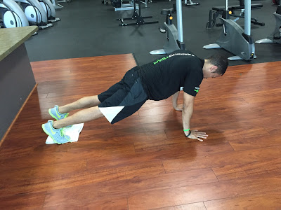 Plank-Drag-With-Feet-on-Towel